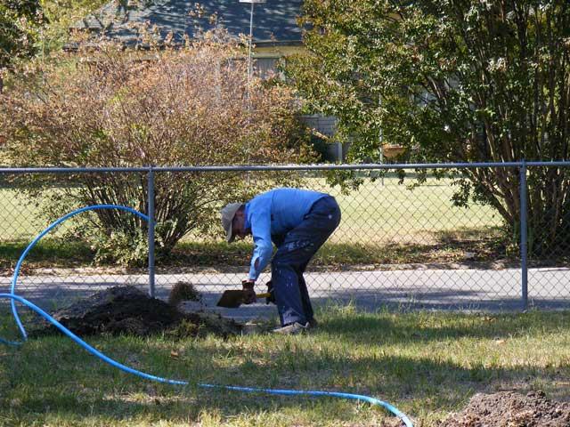 Dad, digging a ditch