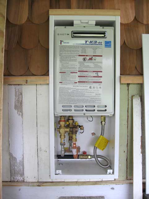 The tank-less water heater mounted...there is a nice cover-door for that cabinet