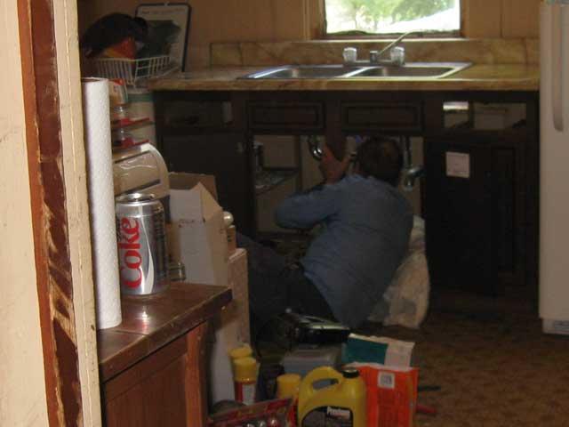 My 80 year old Dad, working under the sink