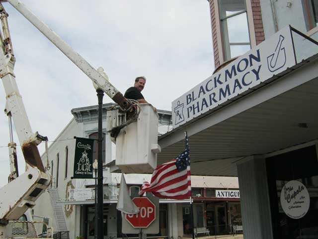 Putting up the new sign for The Cupola